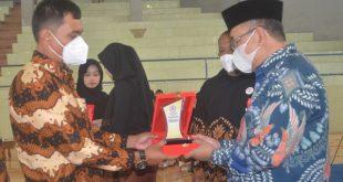 Sekda Lampura Hadiri Pelantikan Dan Pengukuhan DPC Asosiasi Kontraktor Nasional Di GOR Sukung